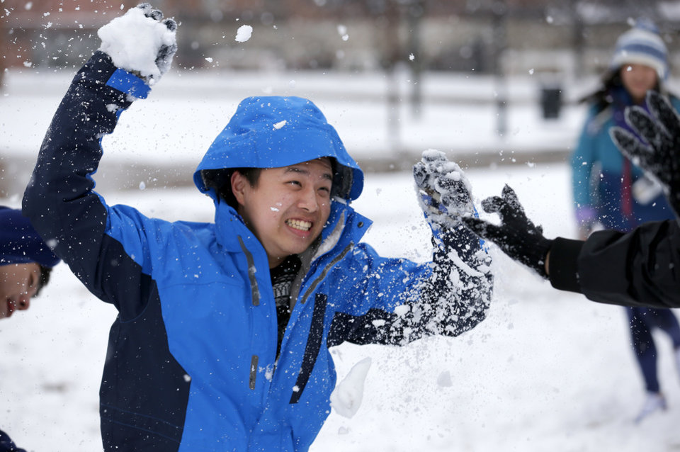 Will Tang throws a snowball at the University of Central Oklahoma in Edmond, Okla., Wednesday, Feb. 13, 2013.Photo by Sarah Phipps, The Oklahoman