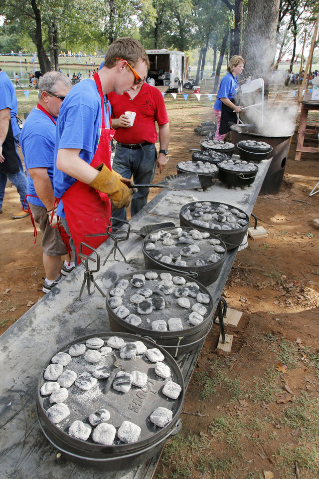 Photo - Philip Dillow bakes various types of breads in Dutch ovens during school day of the Oklahoma Wildlife Expo at the Lazy E Arena and Ranch in Guthrie, OK, Friday, September 28, 2012,  By Paul Hellstern, The Oklahoman