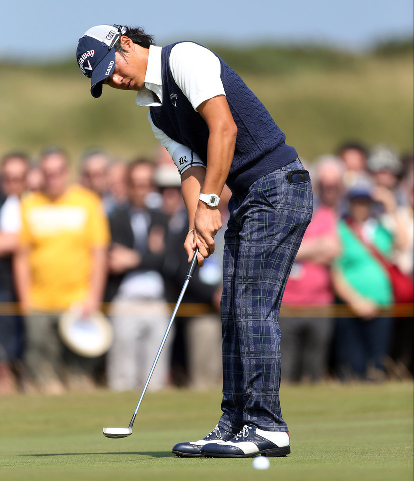 Photo - Ryo Ishikawa of Japan prepares to putt on the 6th green during the second day of the British Open Golf championship at the Royal Liverpool golf club, Hoylake, England, Friday July 18, 2014. (AP Photo/Peter Morrison)
