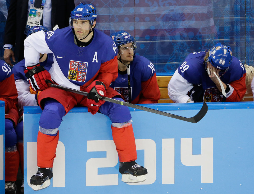 Photo - Czech Republic forward Jaromir Jagr sits on the boards waiting to enter the game during the third period of men's quarterfinal hockey game against the United States in Shayba Arena at the 2014 Winter Olympics, Wednesday, Feb. 19, 2014, in Sochi, Russia. (AP Photo/David J. Phillip )