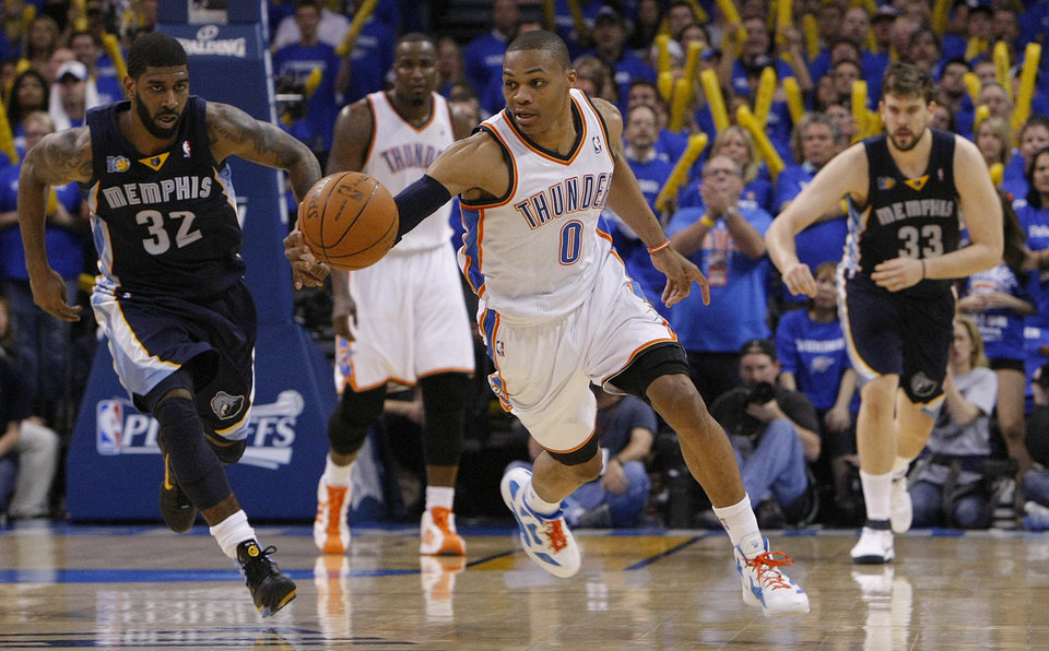 Oklahoma City\'s Russell Westbrook (0) takes the ball up court on a fast break steal during game two of the Western Conference semifinals between the Memphis Grizzlies and the Oklahoma City Thunder in the NBA basketball playoffs at Oklahoma City Arena in Oklahoma City, Tuesday, May 3, 2011. Photo by Chris Landsberger, The Oklahoman