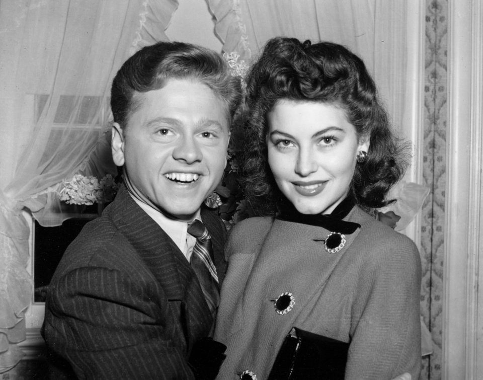 Photo - FILE - In this Jan. 5, 1942, file photo, Mickey Rooney, 21, Movieland's No. 1 box office star, and Ava Gardner, 19, of Wilson, N.C., pose together in Santa Barbara, Calif., shortly after the couple applied for a marriage license. Rooney, a Hollywood legend whose career spanned more than 80 years, has died. He was 93. Los Angeles Police Commander Andrew Smith said that Rooney was with his family when he died Sunday, April 6, 2014, at his North Hollywood home. (AP Photo/File)