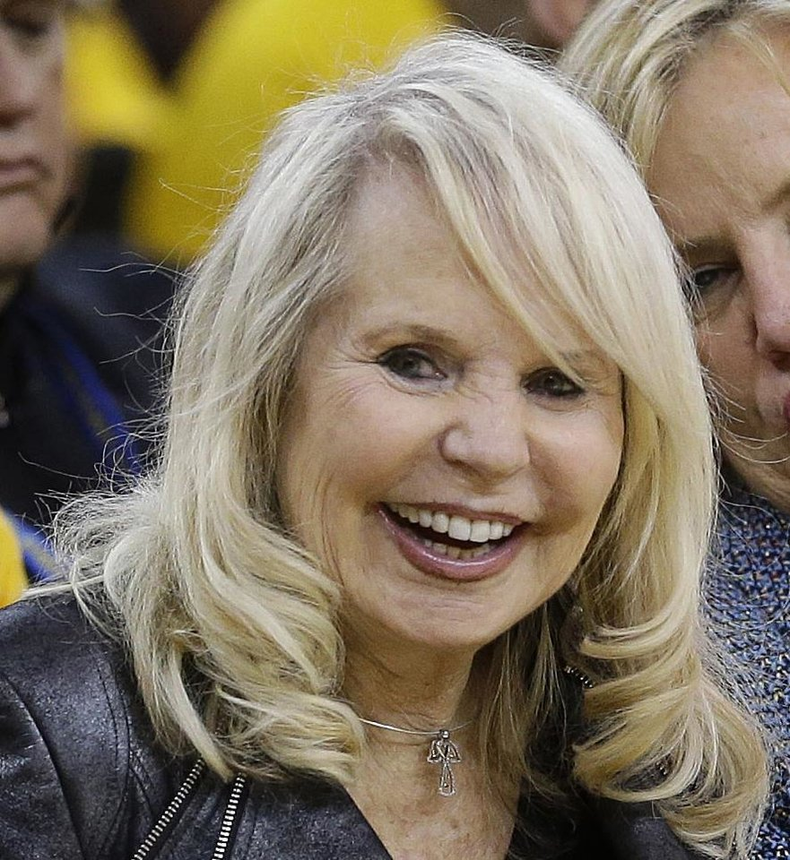 Photo - FILE - In this April 27, 2014 file photo, Shelley Sterling, estranged wife of Los Angeles Clippers owner Donald Sterling, watches from a court side seat during the second half in Game 4 of an opening-round NBA basketball playoff series between the Clippers and Golden State Warriors in Oakland, Calif. With the potentially record-breaking $2 billion sale of the Los Angeles Clippers hanging in the balance, a trial beginning Monday, July 7, 2014 will focus on whether Shelly Sterling had the authority under terms of a family trust to unilaterally negotiate the deal. (AP Photo/Marcio Jose Sanchez, File)