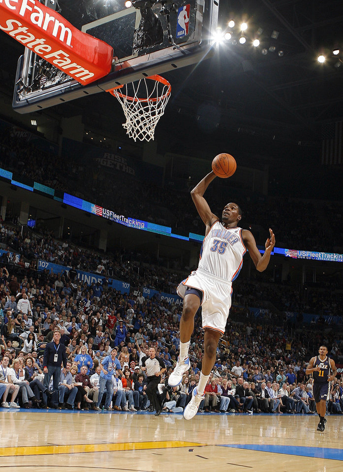 Photo - Oklahoma City's Kevin Durant dunks the ball during the NBA basketball game between the Oklahoma City Thunder and Utah Jazz in the Oklahoma City Arena on Sunday, Oct. 31, 2010. Photo by Sarah Phipps, The Oklahoman