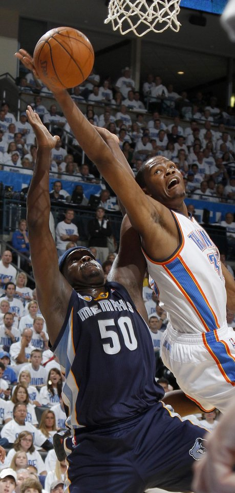 Photo - Oklahoma City's Kevin Durant (35) goes to the basket over Zach Randolph (50) of Memphis during game five of the Western Conference semifinals between the Memphis Grizzlies and the Oklahoma City Thunder in the NBA basketball playoffs at Oklahoma City Arena in Oklahoma City, Wednesday, May 11, 2011. Photo by Bryan Terry, The Oklahoman