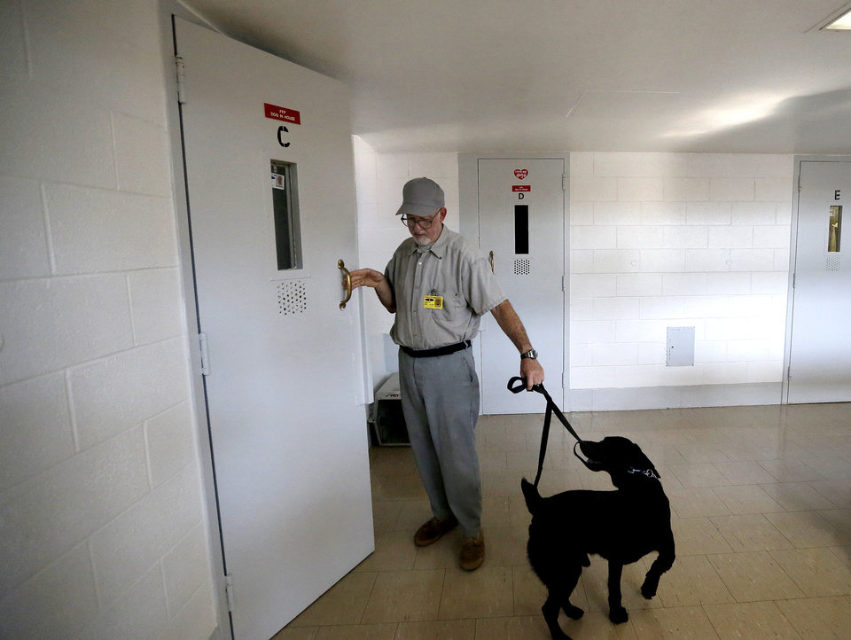 Inmate Steve Griffith leaves his prison cell with Dillard at the Lexington Assessment and Reception Center, Friday, July 11,  2013, in Lexington, Okla. Dillard was rescued after the May tornado.Photo by Sarah Phipps, The Oklahoman