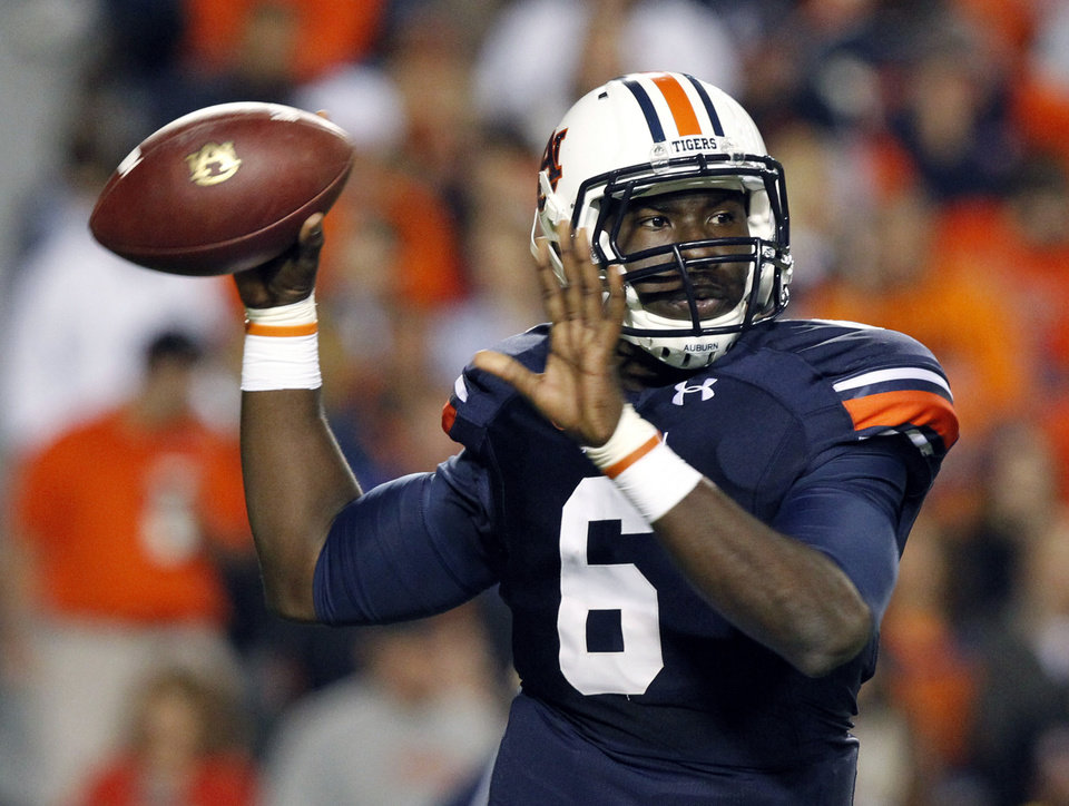 Photo - FILE - In this Oct. 26, 2013, file photo, Auburn quarterback Jeremy Johnson rolls out to pass during the first half of an NCAA college football game against Florida Atlantic in Auburn, Ala.  Johnson says he has no idea if he's starting against Arkansas with starter Nick Marshall being held out for at least the opening. He does have one prediction: Marshall will win the Heisman Trophy. (AP Photo/Butch Dill, File)