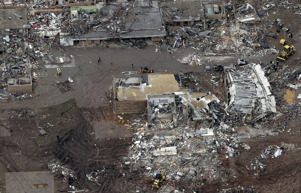 """Photo - FILE - A Tuesday, May 21, 2013 file photo, an aerial view shows Plaza Towers Elementary School, which was destroyed in Monday's tornado, in Moore, Okla. Unlike several others schools in the Oklahoma City area, Plaza Towers had no """"safe room"""" in which students and teachers could huddle. The deaths of seven students at Plaza Towers highlights the patchwork of protection that exists at schools in tornado-prone parts of the central U.S.  (AP Photo/Tony Gutierrez, File)"""