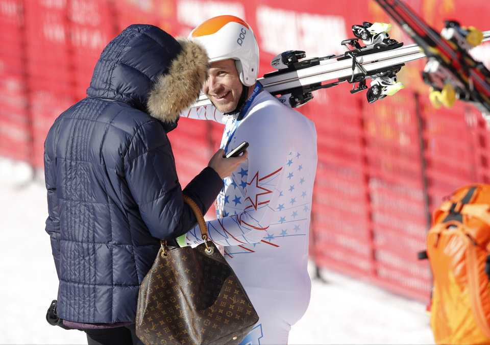 Photo - United States' Bode Miller smiles at his wife, Morgan, in the finish area after a men's downhill training run for the Sochi 2014 Winter Olympics, Saturday, Feb. 8, 2014, in Krasnaya Polyana, Russia.(AP Photo/Christophe Ena)