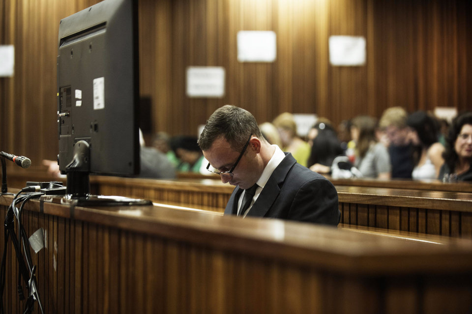 Photo - Oscar Pistorius sits in the dock in court in Pretoria, South Africa, Wednesday, May 14, 2014,  as the judge overseeing his murder trial ordered him to undergo psychiatric tests, meaning that the trial proceedings will be delayed. The court adjourned until May 21, 2014. Pistorius is charged with murder for the shooting death of his girlfriend Reeva Steenkamp on Valentine's Day in 2013.   (AP Photo/Gianluigi Guercia, Pool)