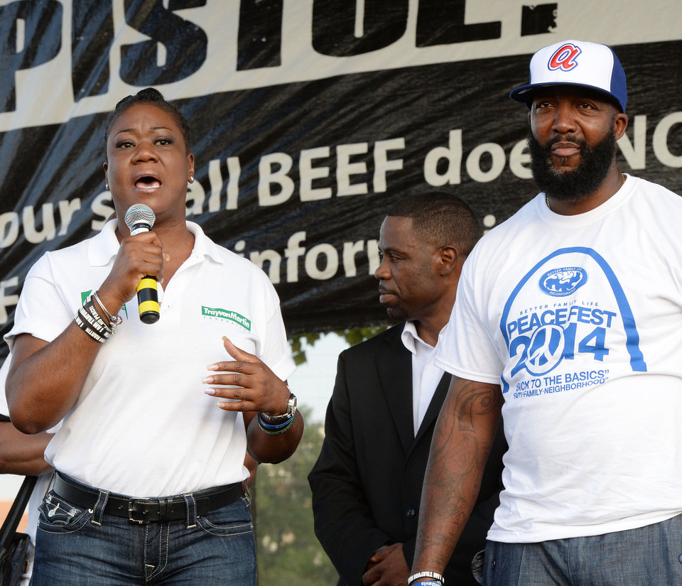 Photo - Sybrina Fulton, left, and Tracey Martin, right, the parents of Trayvon Martin, speak to the crowd at Peace Fest, Sunday, Aug. 24, 2014, in St. Louis. Hundreds of people gathered in St. Louis' largest city park Sunday at a festival that promoted peace over violence. (AP Photo/Bill Boyce)