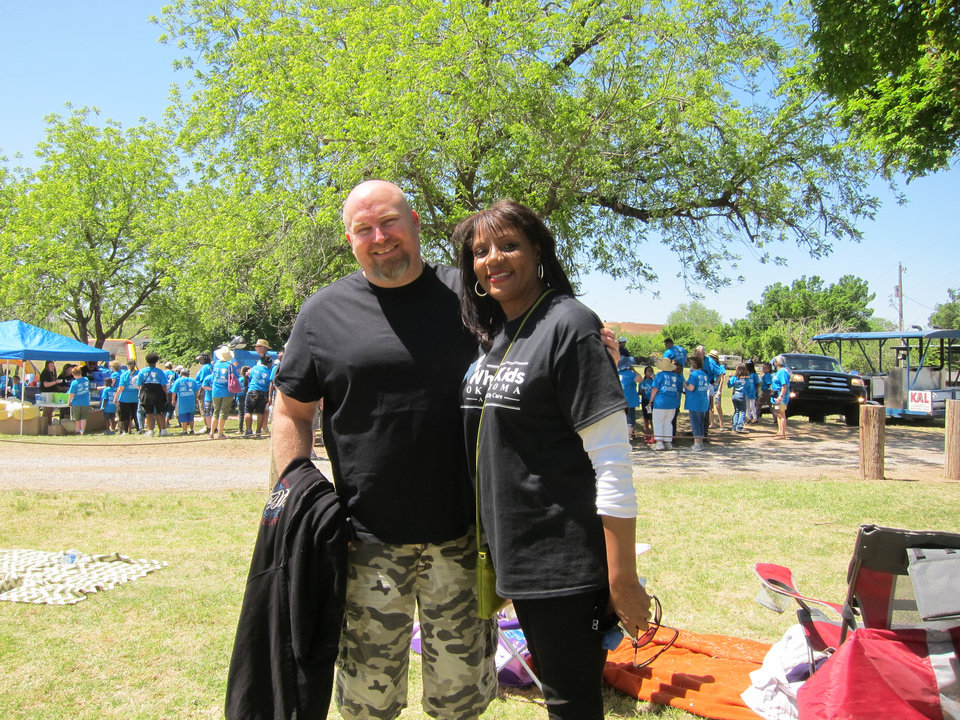 "Photo -  The Rev. Trevor Williams, campus pastor of LifeChurch.tv-Edmond, poses for a picture with Bea Jai  Webb, executive director of Whiz Kids, during the faith-based program's annual ""Spring Fling"" celebration at Crystal Lake. Photo by Carla Hinton, The Oklahoman"