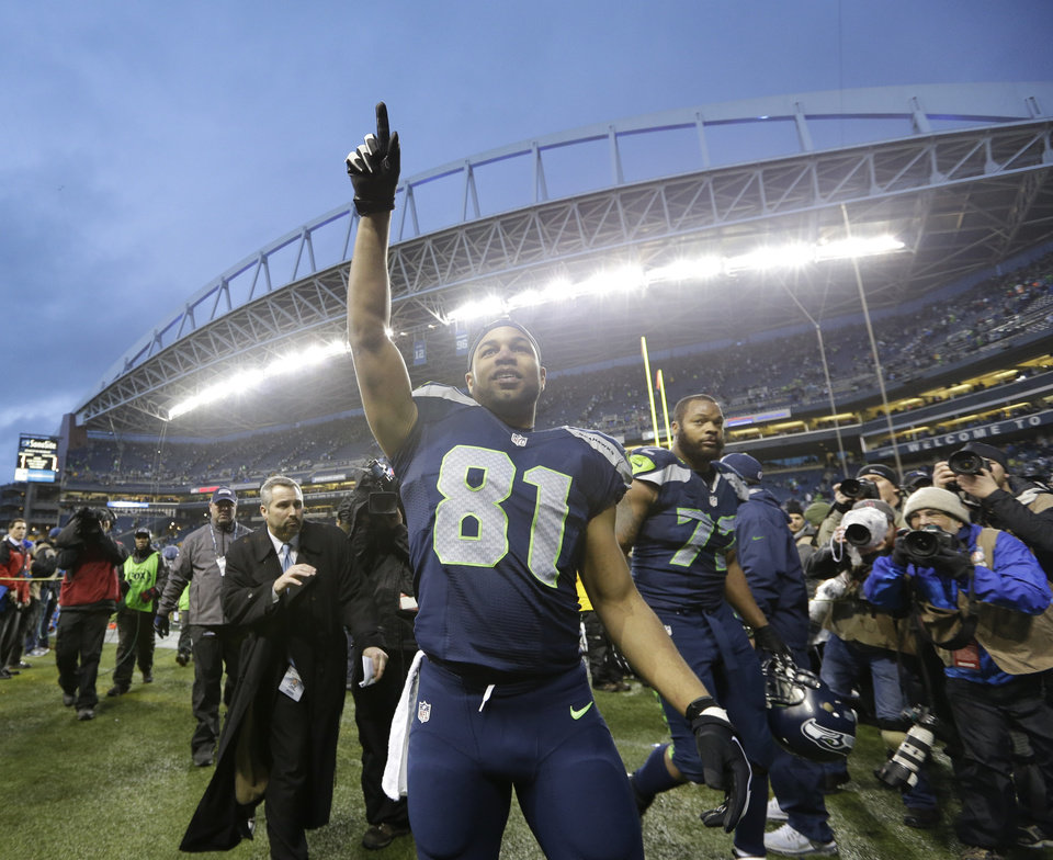 Photo - Seattle Seahawks wide receiver Golden Tate celebrates after an NFC divisional playoff NFL football game against the New Orleans Saints in Seattle, Saturday, Jan. 11, 2014. The Seahawks won 23-15. (AP Photo/Elaine Thompson)