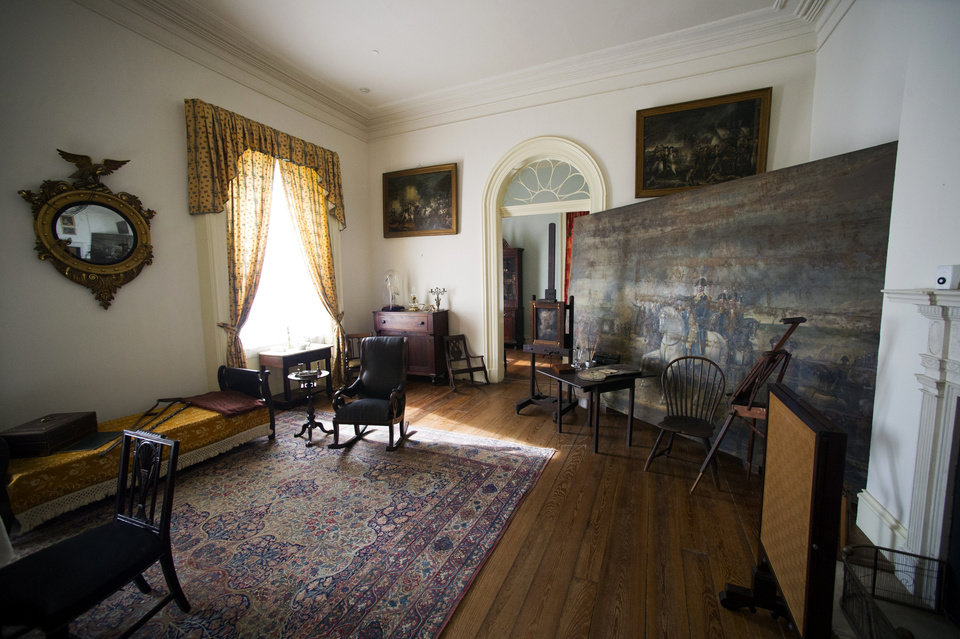 Photo - A room in the historic Arlington House, at Arlington National Cemetery is seen in Arlington, Va., Thursday, July 17, 2014. The historic house and plantation originally built as a monument to George Washington overlooking the nation's capital that later was home to Confederate Gen. Robert E. Lee and 63 slaves will be restored to its historical appearance after a $12.3 million gift from Philanthropist David Rubenstein. (AP Photo/Cliff Owen)