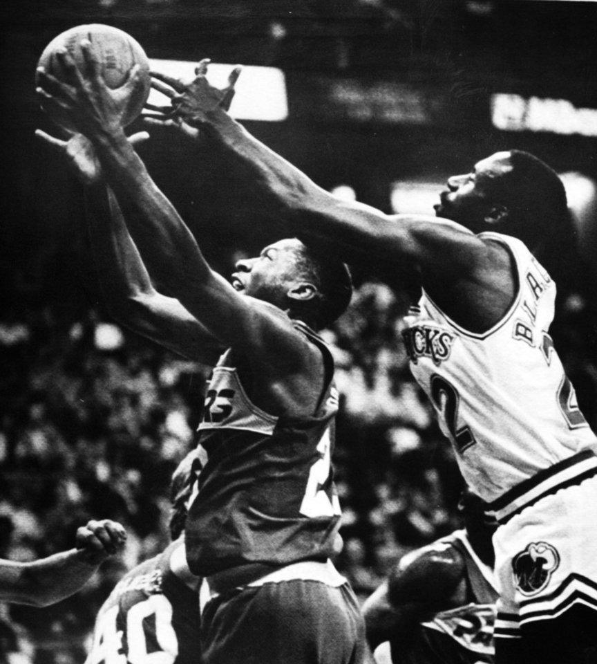 Photo - Former OU basketball player Wayman Tisdale. Dallas Maverick Rolando Blackman reaches around Indiana Pacer Wayman Tisdale as the former Oklahoma Sooner pulls down a rebound. Tisdale netted 27 points Monday night. (AP LaserPhoto)  Photo taken unknown, Photo published 1/6/1987 in The Daily Oklahoman. ORG XMIT: KOD