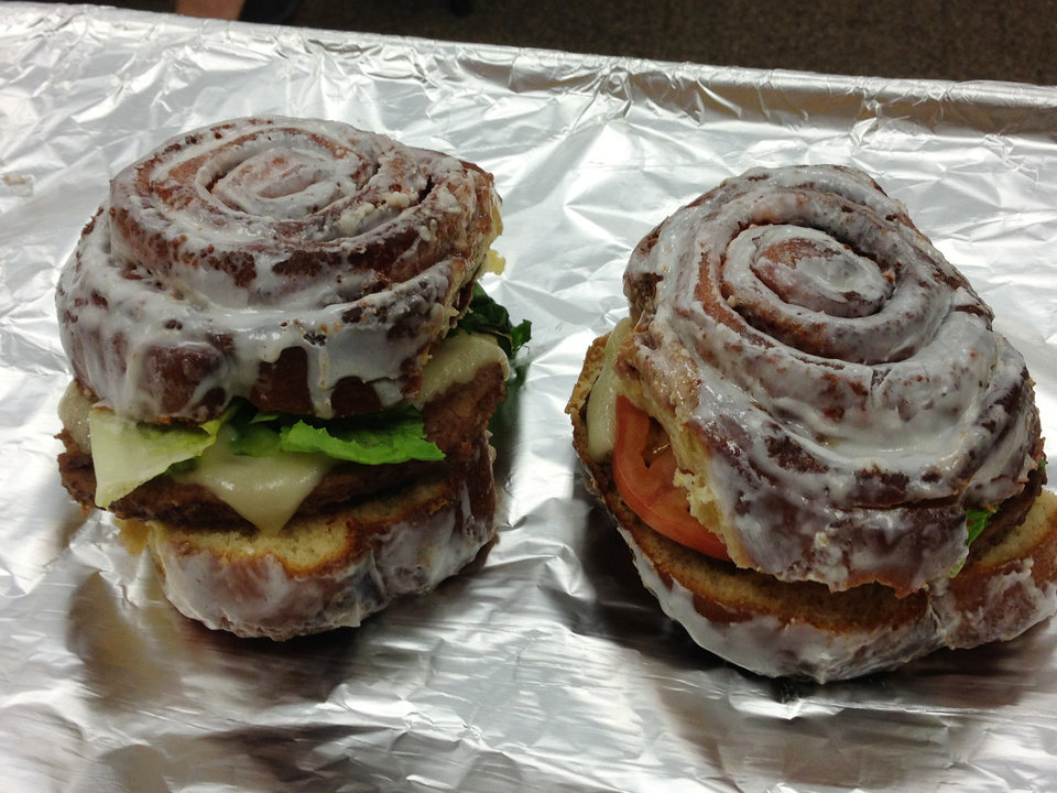 Photo - The Cinna-Burger is a burger served on a split cinnamon roll.  DAVE CATHEY - THE OKLAHOMAN