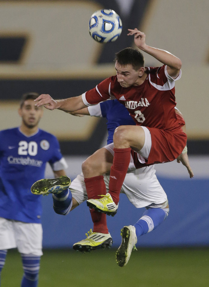 Photo - Indiana's Nikita Kotlov (8) battles for the ball with Creighton's Bruno Castro, rear, as Christian Blandon (20) watches in the second half of a NCAA College Cup men's championship semifinal soccer match at Regions Park, Friday, Dec. 7, 2012, in Hoover, Ala. Indiana won 1-0. (AP Photo/Dave Martin)