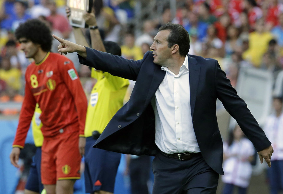 Photo - Belgium's head coach Marc Wilmots gestures as he prepares to introduce Belgium's Marouane Fellaini to the match during the group H World Cup soccer match between Belgium and Algeria at the Mineirao Stadium in Belo Horizonte, Brazil, Tuesday, June 17, 2014. (AP Photo/Hassan Ammar)
