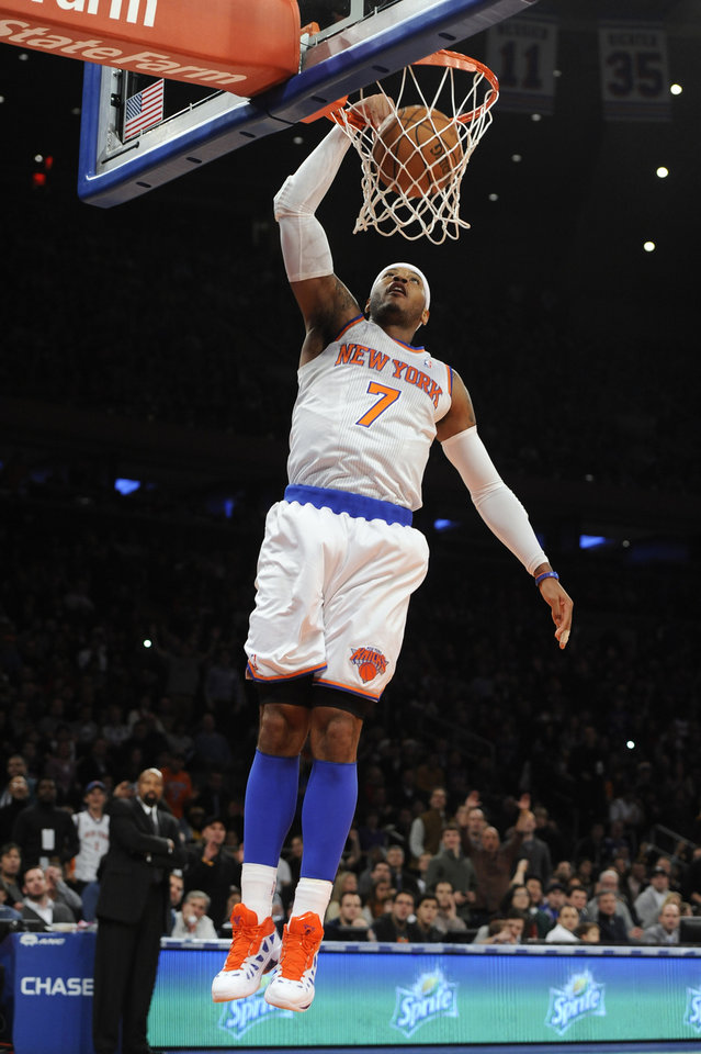 New York Knicks'  Carmelo Anthony (7) dunks a basket against the Minnesota Timberwolves in the first half of an NBA basketball game on Sunday, Dec., 23, 2012, at Madison Square Garden in New York. (AP Photo/Kathy Kmonicek)