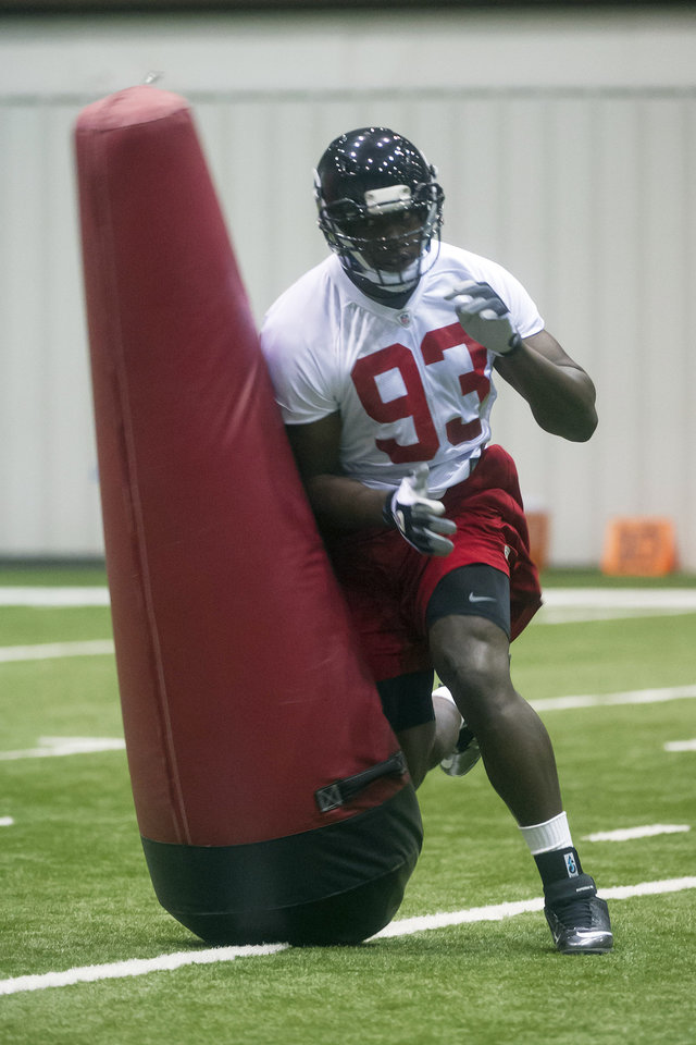 Photo - Atlanta Falcons defensive end Malliciah Goodman, from Clemson, works out during NFL football rookie minicamp, Saturday, May 4, 2013, in Flowery Branch, Ga. (AP Photo/John Amis)