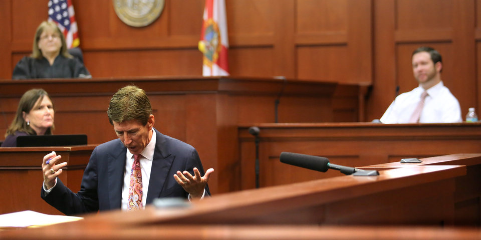 Photo - Defense attorney Mark O'Mara, front left, drops to his knees in questioning eyewitness Jonathan Good, right, during the George Zimmerman trial, with Judge Debra Nelson in background, back left, during the 15th day of the trial in Seminole circuit court, in Sanford, Fla., Friday, June 28, 2013. Zimmerman has been charged with second-degree murder for the 2012 shooting death of Trayvon Martin. (AP Photo/Orlando Sentinel, Joe Burbank, Pool)