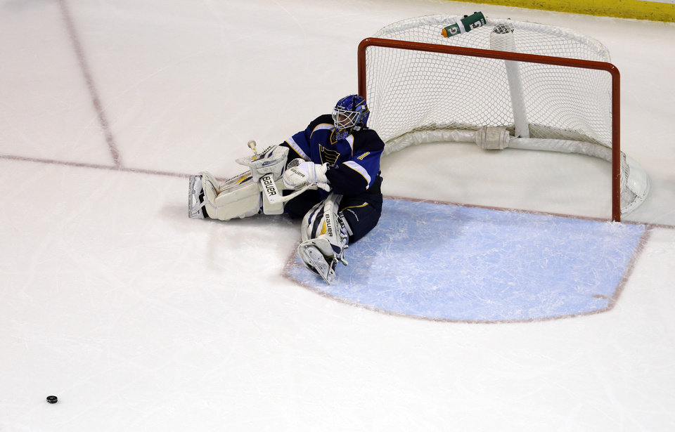 St. Louis Blues goalie Brian Elliott sits on the ice after giving up a goal to Los Angeles Kings\' Jeff Carter during the second period of an NHL hockey game, Monday, Feb. 11, 2013, in St. Louis. The goal was Carter\'s second of the game against Elliott. (AP Photo/Jeff Roberson)