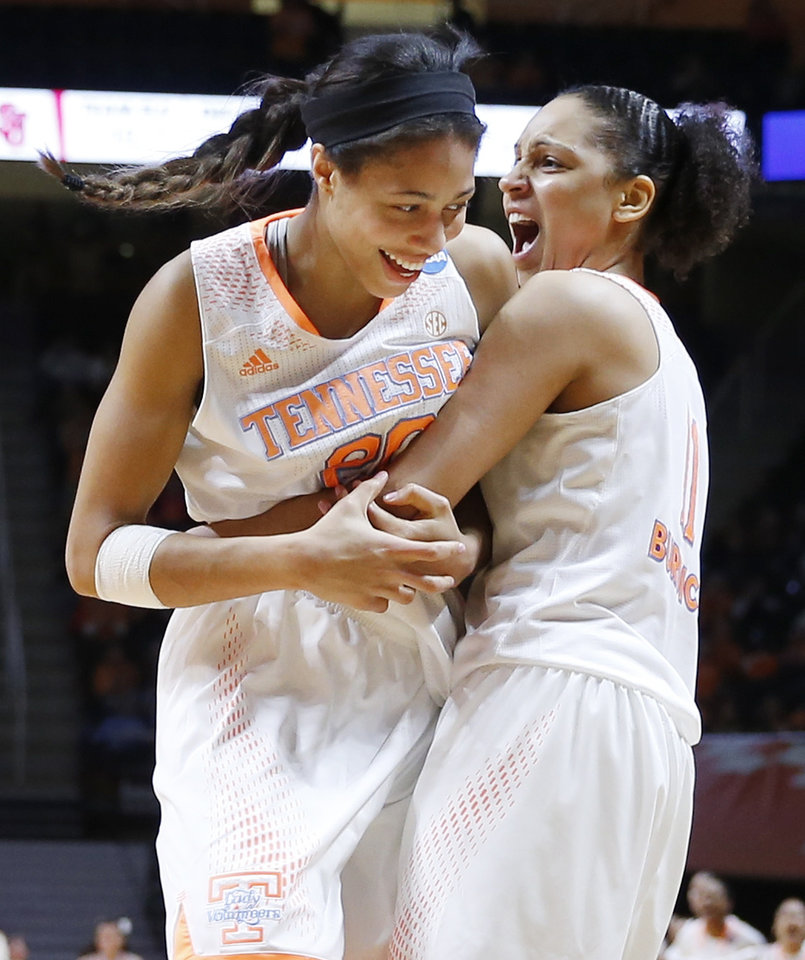 Photo - Tennessee's Isabelle Harrison, left, and Cierra Burdick, right, celebrate a score against St. John's in the first half of an NCAA women's college basketball second-round tournament game Monday, March 24, 2014, in Knoxville, Tenn. (AP Photo/John Bazemore)