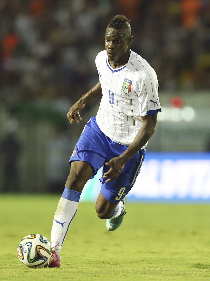 Photo - Italy's national soccer team player Mario Balotelli controls the ball during a World Cup warm up soccer match between Italy and Fluminense at the Cidadania stadium, in Volta Redonda, Brazil, Sunday, June 8, 2014. Italy plays in group D of the 2014 soccer World Cup. (AP Photo/Antonio Calanni)
