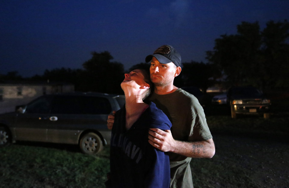 Amber Ash is comforted by her boyfriend, Bobby Hogan, in Dale, Okla., near Steelman Estates mobile home park which was hit by a tornado, Sunday, May 19, 2013. Ash said she and her family sought safety in a shelter at the park during the storm. Ash\'s home was destroyed by the tornado. Photo by Sarah Phipps, The Oklahoman
