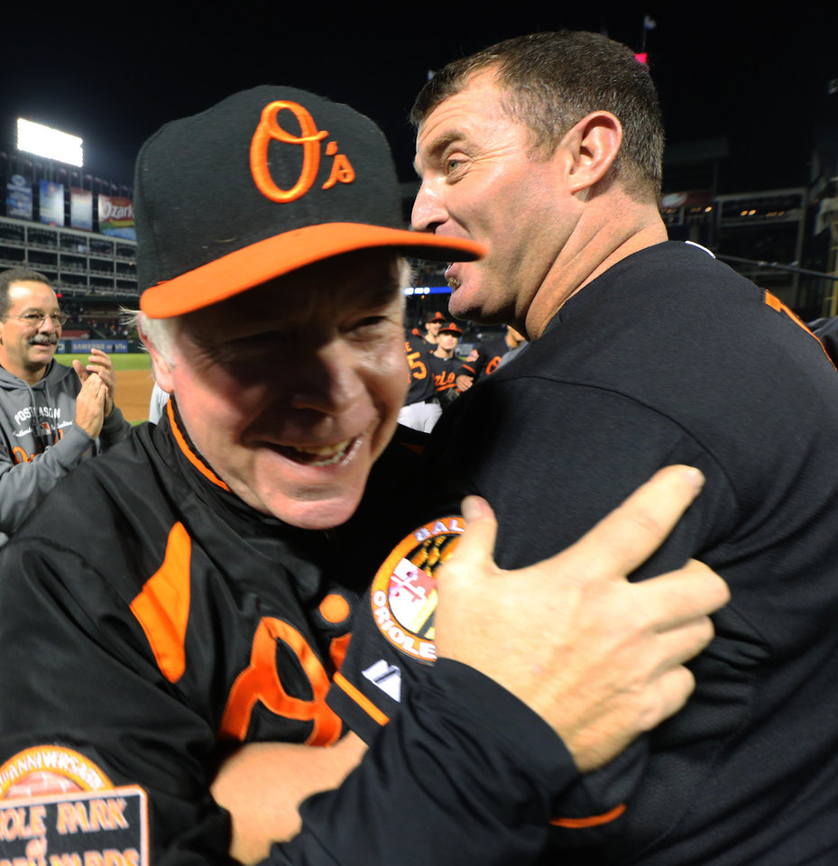 Photo -   Baltimore Orioles manager Buck Showalter ,left, and designated hitter Jim Thome embrace after beating the Texas Rangers 5-1 in the American League wild-card playoff baseball game Friday, Oct. 5, 2012 in Arlington, Texas. (AP Photo/LM Otero)