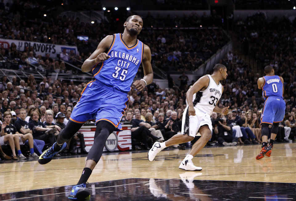 Photo - Oklahoma City's Kevin Durant (35) reacts after missing a pass during Game 1 of the Western Conference FInals in the NBA playoffs between the Oklahoma City Thunder and the San Antonio Spurs at the AT&T Center in San Antonio, Monday, May 19, 2014. Photo by Sarah Phipps, The Oklahoman