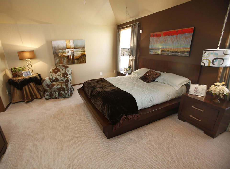 The master bedroom in the J.W. Mashburn home at 3125 SW 136 Terrace is spacious, with room for a sitting area.