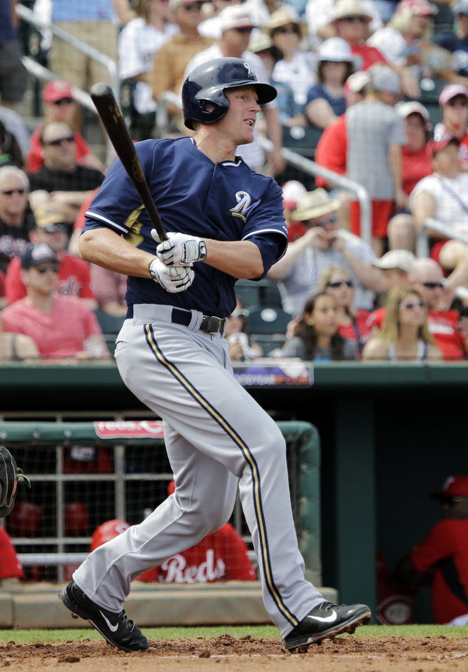 Photo - Milwaukee Brewers' Mat Gamel  watches his double to drive in a run in the third inning of a spring exhibition baseball game against the Cincinnati Reds Sunday, March 23, 2014, in Goodyear, Ariz. (AP Photo/Mark Duncan)