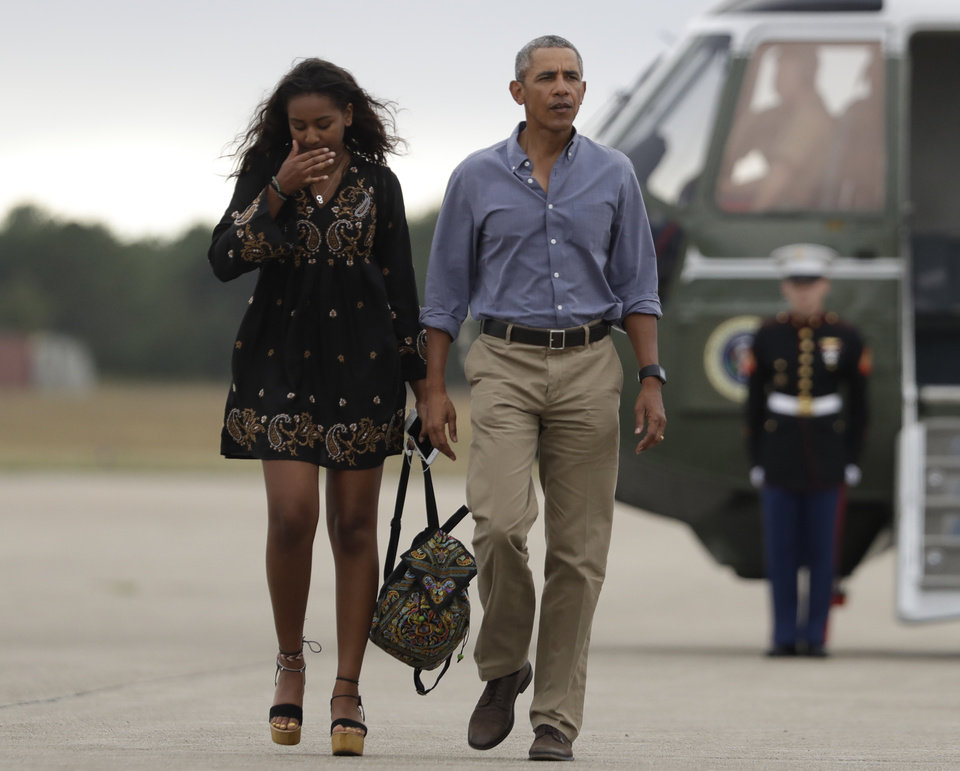 "Photo - President Barack Obama and his daughter Sasha walk on the tarmac to board Air Force One at Air Station Cape Cod in Mass., Sunday, Aug. 21, 2016. Obama is returning from vacation rested and ready for a busy fall, including pressing Congress for money to protect against the Zika virus and fending off lawmakers' attacks over the administration's $400 million ""leverage"" payment to Iran. (AP Photo/Manuel Balce Ceneta)"