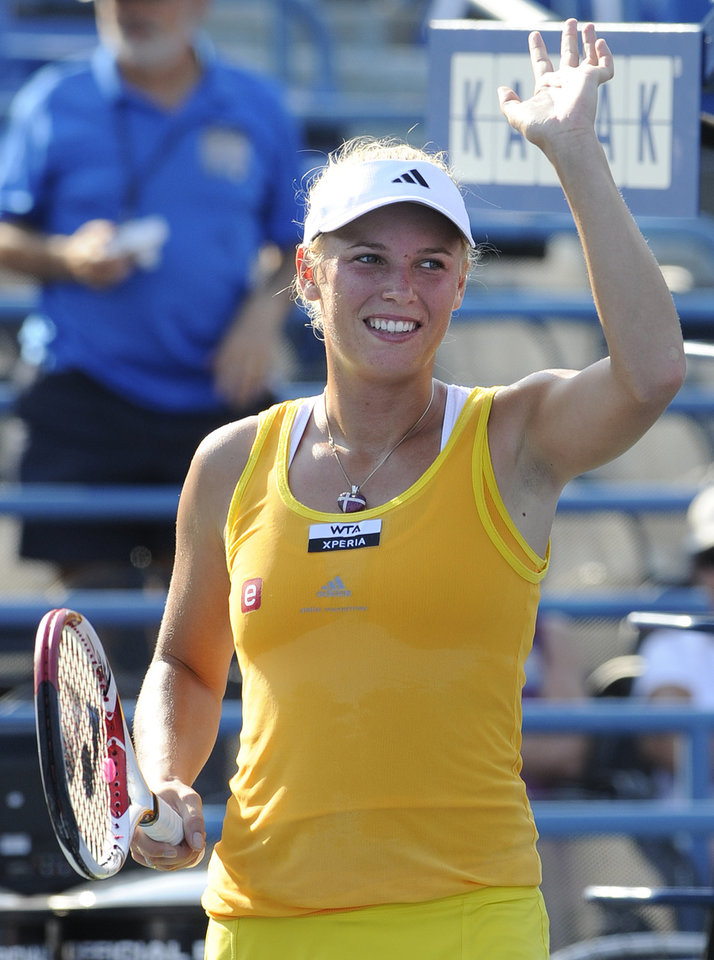 Photo -   Caroline Wozniacki, of Denmark, waves to the crowd after her 7-6 (4), 6-2 victory over Sofia Arvidsson, of Sweden, during the second round of the New Haven Open tennis tournament in New Haven, Conn., on Wednesday, Aug. 22, 2012. (AP Photo/Fred Beckham)