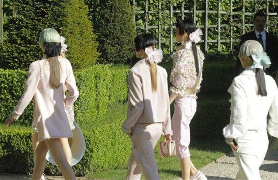 Models present creations by German fashion designer Karl lagerfeld for Chanel's. Monday, May, 14, 2012. Master of Fashion, Karl Lagerfeld spares no expenses for his  midseason Chanel Cruise show offering held at the former home of Marie Antoinette, the Chateau de Versailles, southwest of Paris. (AP Photo/Jacques Brinon)