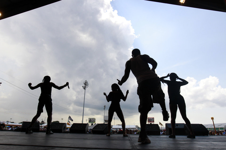 Dancers perform the 'Sissy Bounce' during the 'Bounce Shakedown' at the New Orleans Jazz and Heritage Festival in New Orleans, Sunday, May 6, 2012. The bounce is described by the festival as 'hypersexual dancing and a call-and-response-style party atmosphere.' (AP Photo/Gerald Herbert)