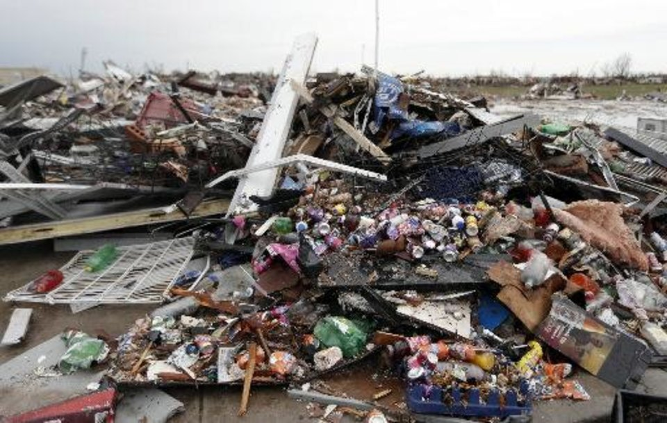 Photo - The May 20 Moore tornado destroyed the 7-Eleven at 4th and Telephone Road where three people where killed and Edith Morales was critically injured. PHOTO BY SARAH PHIPPS, THE OKLAHOMAN.  SARAH PHIPPS - THE OKLAHOMAN