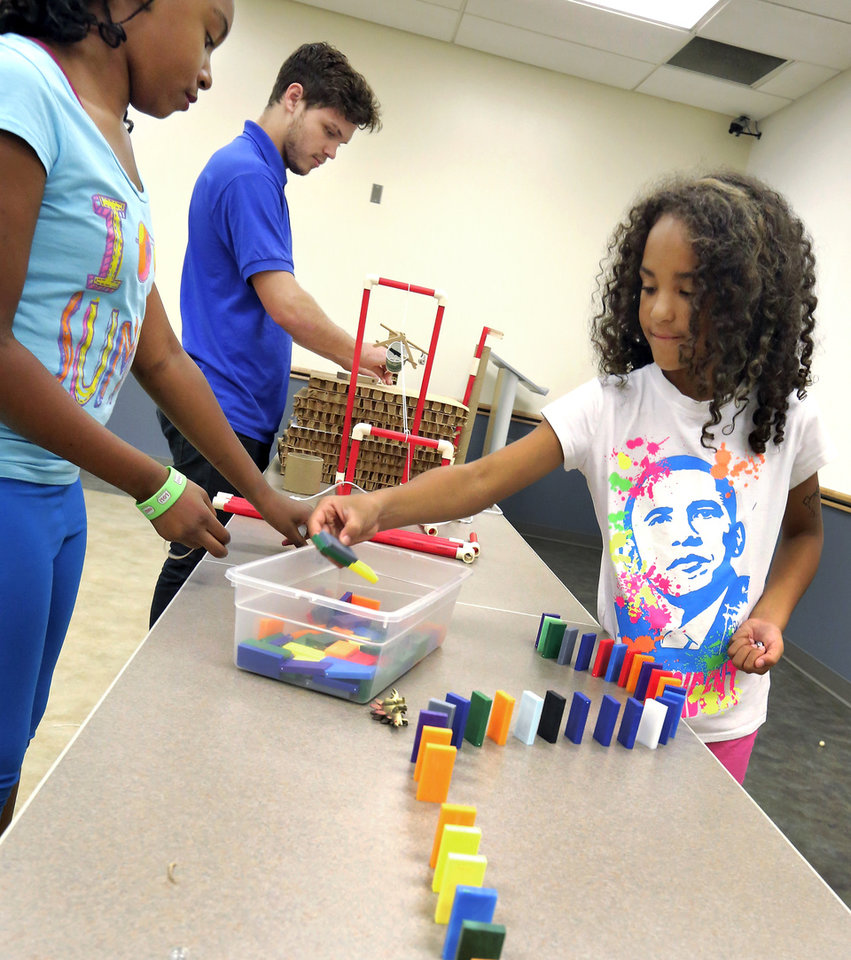 "Photo -  Londyn Johnson, 10, Cora Linden, 9, and Tyler Troy set up an experiment at ""Imagineering"" camp. Theme of the project was learning engineering through chain reactions. Photo by Jim Beckel, The Oklahoman   Jim Beckel -"