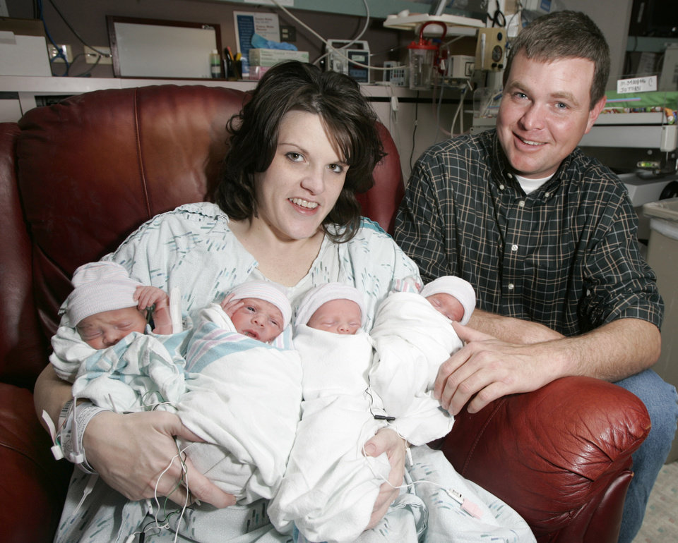 Jennifer and Rick Payne hold their newborn quadruplets  at Mercy Health Center in Oklahoma City on Dec. 17, 2007. Photo BY STEVE GOOCH, THE OKLAHOMAN Archives