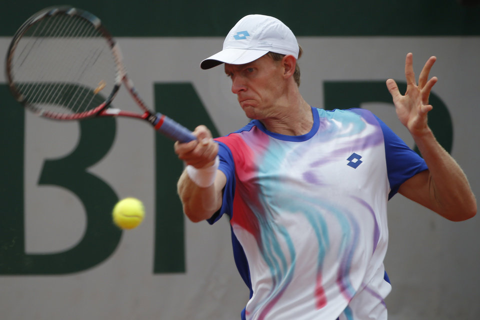 Photo - South Africa's Kevin Anderson returns the ball during the fourth round match of the French Open tennis tournament against Spain's David Ferrer at the Roland Garros stadium, in Paris, France, Monday, June 2, 2014.  (AP Photo/Michel Euler)