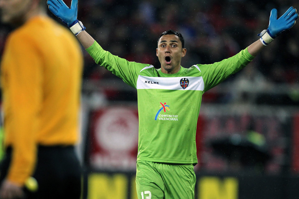 Photo - FILE - This Feb. 21, 2013 file photo shows Levante's goalkeeper Keylor Navas, of Costa Rica, during a Europa League round of 32 soccer match against Olympiakos at the Karaiskaiki stadium in the port of Piraeus, near Athens. Real Madrid says it has signed Navas from Levante following his stellar World Cup campaign. The Champions League winner said on its website Sunday, Aug. 3, 2014 that Navas agreed to a six-year deal and will be presented at the Santiago Bernabeu stadium on Tuesday after undergoing a medical exam. (AP Photo/Thanassis Stavrakis, file)