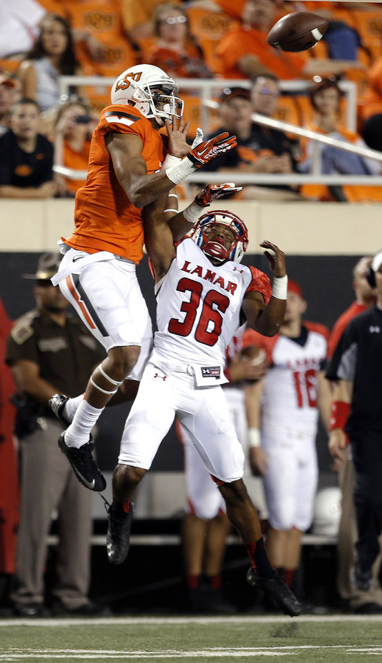 Photo - Oklahoma State's Marcell Ateman (3) makes a catch over Lamar's Lloyd Julian (36) during a college football game between the Oklahoma State University Cowboys (OSU) and the Lamar University Cardinals at Boone Pickens Stadium in Stillwater, Okla., Saturday, Sept. 14, 2013. Photo by Sarah Phipps, The Oklahoman