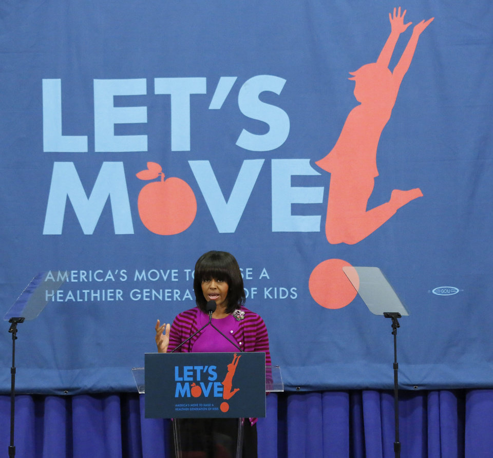 First lady Michelle Obama greets educators and state and community officials at a