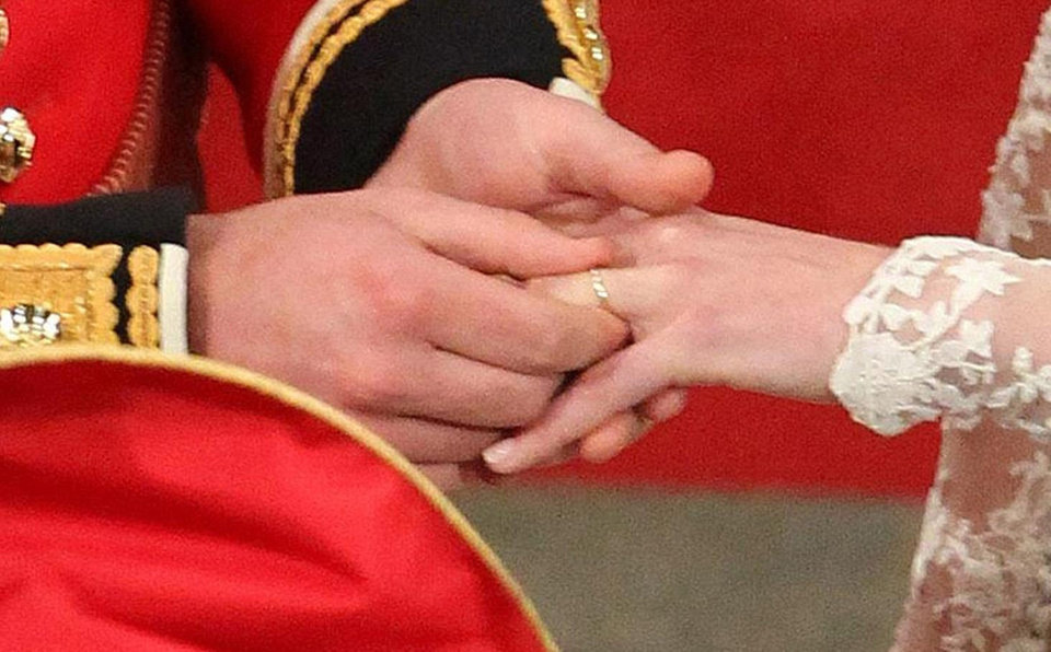 Photo - Britain's Prince William and Kate Middleton exchange rings during their wedding service at Westminster Abbey, in London, Friday April 29, 2011. (AP Photo/Andrew Milligan, Pool)  ORG XMIT: RWAJP143