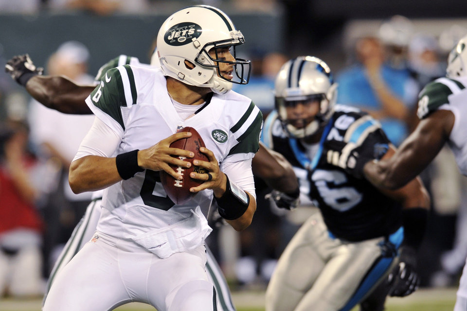 Photo -   New York Jets quarterback Mark Sanchez (6) looks to pass during the first half of a preseason NFL football game against the Carolina Panthers, Sunday, Aug. 26, 2012, in East Rutherford, N.J. (AP Photo/Bill Kostroun)