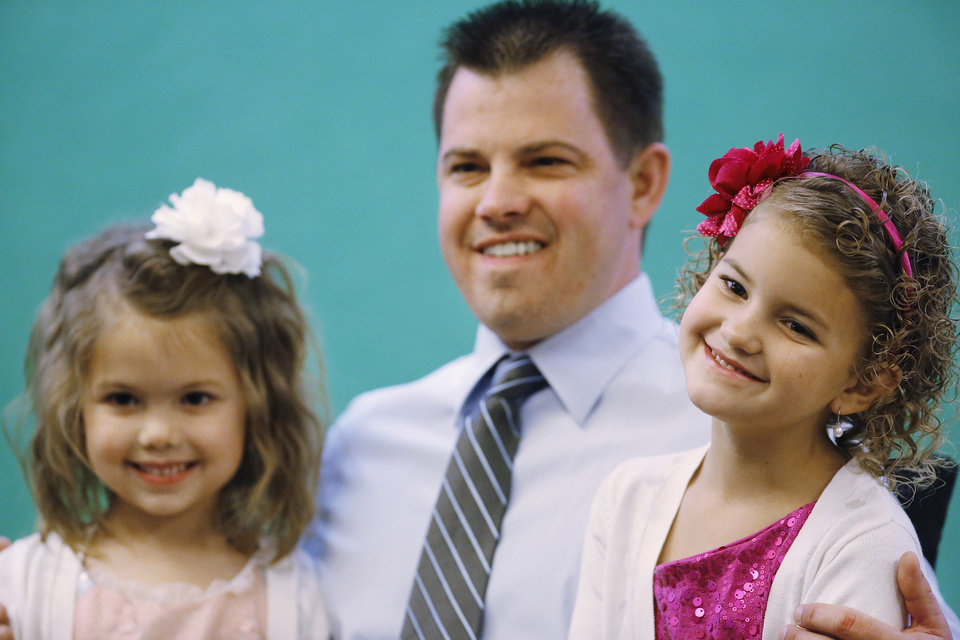 A dad and two daughters pose for a souvenir picture. Midwest City Parks and Recreation Department hosted the city's annual Daddy-Daughter Dance that featured three 90-minute dance sessions at the Reed Center on Saturday, Feb. 16, 2013.    Photo by Jim Beckel, The Oklahoman
