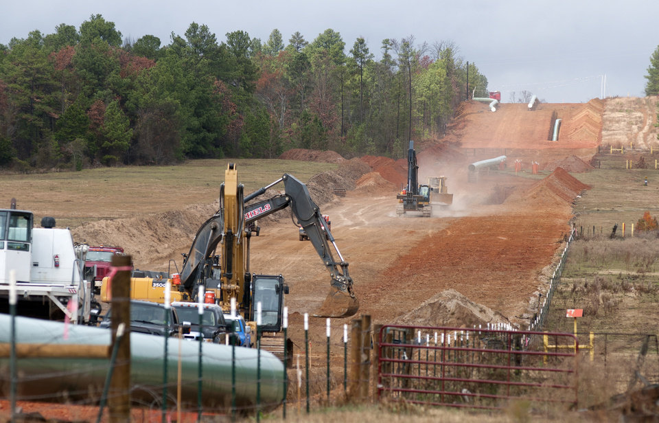 Photo -  Crews work on construction of the TransCanada Keystone XL Pipeline near County Road 363 and County Road 357, east of Winona, Texas.  AP File Photo   Sarah A. Miller -  AP