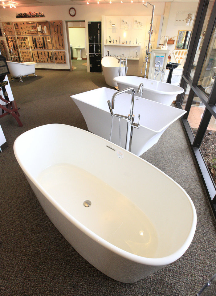 Photo - Tubs are on display in one of the showrooms at Designer Hardware by Faye.  PAUL B. SOUTHERLAND -  The Oklahoman