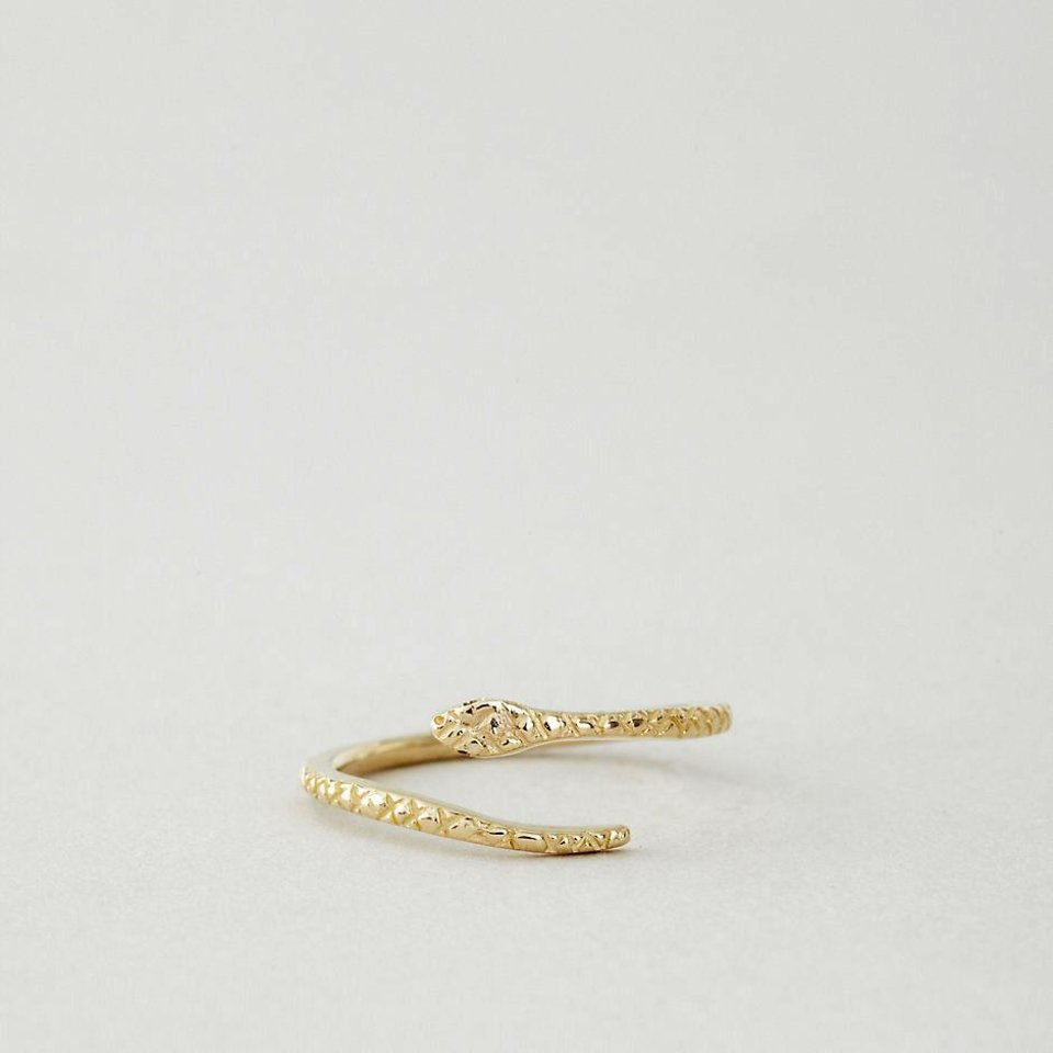 For those who follow the Chinese zodiac, the year of the snake begins Feb. 10. Some ways to incorporate the symbol of the year into your wardrobe, with no harm done to any living creature include a Steven Alan snake ring by Grace Lee, $385 from StevenAlan.com. (StevenAlan.com via Los Angeles Times/MCT)